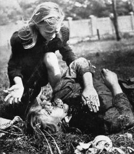 Young Polish girl wailing over the body of her dead sister Sept 1939